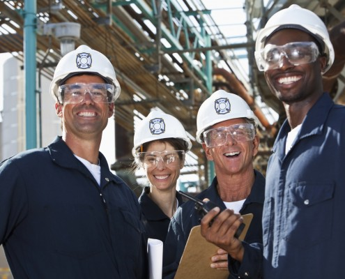 Group of workers at manufacturing plant